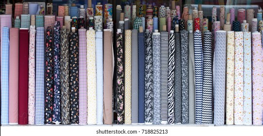 Rolls of fabric and textiles in front of shop