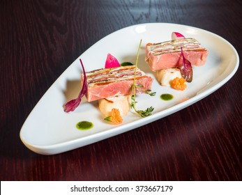 Rolls of ham, cheese, mayonnaise and vegetables