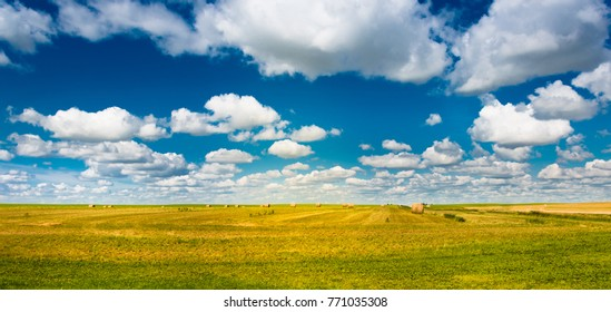 Rolls of hay on a field during a beautiful day