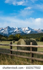 Rolls of hay on a ranch near the Dallas divide Mountains in Southwest Colorado