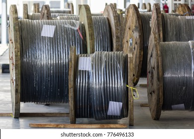 Rolls of high-voltage power cable on floor
