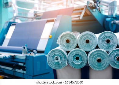 Rolls of industrial cotton fabric for clothing cloth textile manufacture on machine.