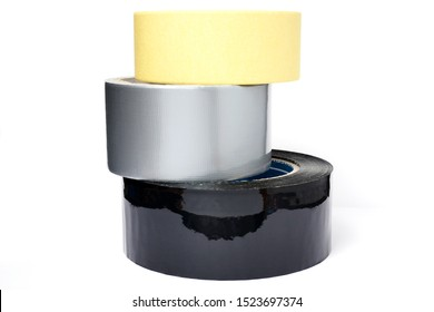 Rolls of insulation adhesive tape; Gray reinforced adhesive tape, yellow adhesive tape, black adhesive tape on white background