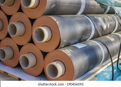 Rolls of insulation material at the construction site. Waterproofing membrane system.