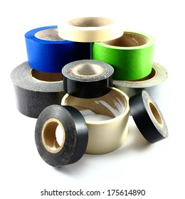 Rolls of old and used tape on white background