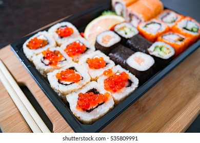 rolls on a plate, rolls, sushi, rolls on the board