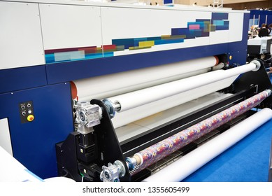 Rolls paper and fabric in wide industrial plotter