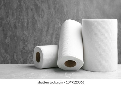 Rolls of paper towels on marble table