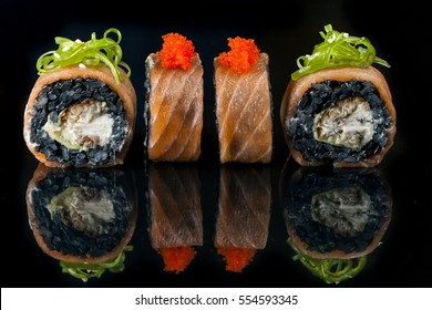 Rolls Philadelphia with a salmon and a black rice