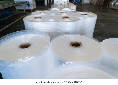 rolls of polyethylene or polypropylene film in a warehouse