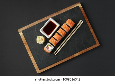Rolls with salmon and tuna on stone plate