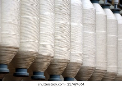 Rolls of spun cotton in a textile factory
