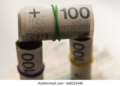 Rolls and stack of Polish Zloty banknotes (PLN) closeup. Polish One Hundred Zlotych bills