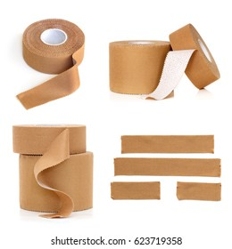 Rolls and strips of physio strapping tape, isolated on white.