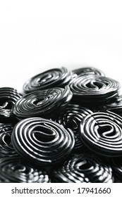 Rolls of tasty liquorice candy rolls isolated on white