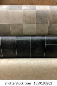 Rolls of vinyl flooring as a background