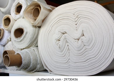 Rolls of white fabric