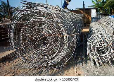 Rolls of wire mesh for reinforcement of concrete floor at the construction site in the sunset