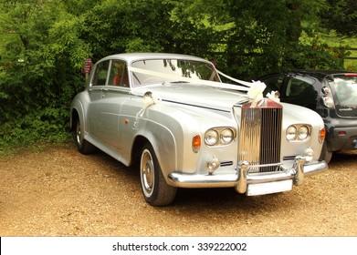 Rolls-royce English white luxurious wedding car in Stourhead, England. 05.30.2015