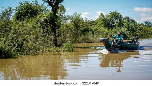 ROLUOS, CAMBODIA, August 15, 2015 : during the wet months, the floating village on the Roluos river at the edge of Tonle Sap, Cambodia is very scenic with fishermen on their unique boat.