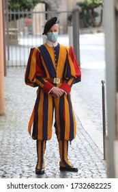 Roma, Italy 10 may 2020: A Swiss guard with the mask at porta sant'anna a San Pietro in Rome. The first weekend to start phase 2 in Italy after the Covid-19 emergency quarantine.