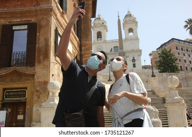 Roma, Italy 17 may 2020: Engaged couple take a selfie in the Spanish Steps in Rome, on the day of the end of the second phase after the quarantine, social life in Italy starts again after the covid-19