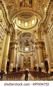 ROMA, ITALY, APRIL 11, 2016: Interiors and architectural details of Sant Andrea della Valle basilica with fresco by Giovanni Lanfranco(1621-1625) and four Evangelists by Carracci school (17. cent.)