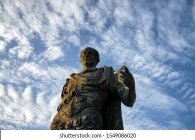 ROMA, ITALY - October 26, 2019: Bronze statue of roman emperor Julius Caesar on the roman forum