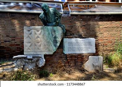 ROMA - JUNE 12, 2018: The statue of Trilussa dominates the Trilussa square in Trastevere on June 12, 2018 in Rome.