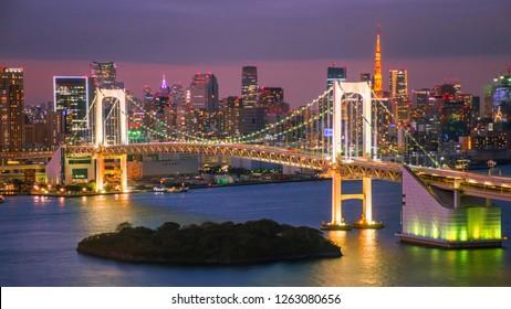 Romactic city night view of Odaiba, Tokyo , Rainbow bridge and Tokyo Tower landmark Twilight scene, Odaiba, Japan with selective focus.