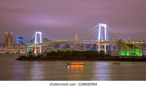 Romactic city night view of Odaiba, Tokyo , Rainbow bridge and Tokyo Tower landmark Twilight scene, Odaiba, Japan.