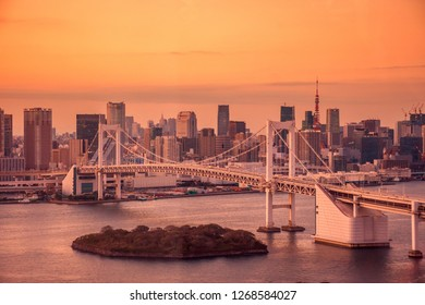 Romactic city night view of Odaiba, Tokyo , Rainbow bridge and Tokyo Tower landmark sunset and twilight scene,taken in cinematic, romatic warm tone style, Odaiba, Japan with selective focus