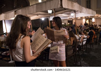 Roma,Italy-August 10, 2018: The nightlife in the Trastevere area. Trastevere is the thirteenth district of Rome, an area frequented by the Roman nightlife and characterized by locals and restaurants