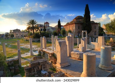Roman Agora with ancient columns and Byzantine church at sunset, Athens, Greece