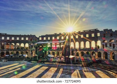 Roman amphi theatre (Arena) in Pula on a bright summer day evening,A wall fragment of ancient Roman amphitheater  Pula, Croatia