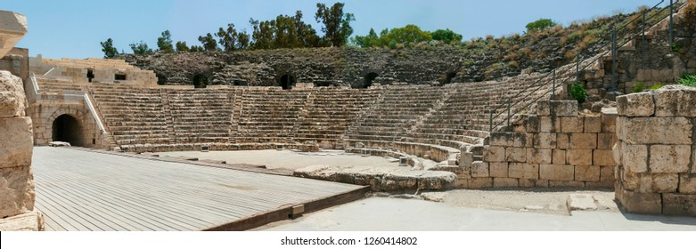 the roman amphitheater at beit shean national park in Israel showing the ancient stone seating and part of a modern stage