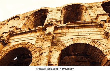 Roman amphitheatre in Arles (Bouches-du-Rhone, Provence-Alpes-Cote d'Azur, France). Toned photo.