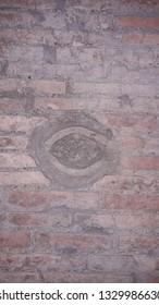 roman ancient brick wall with water pipe