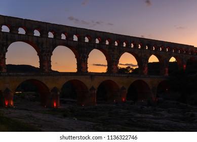 Roman aqueduct of Pont du Gard at dusk, France
