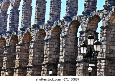 Roman Aqueduct of Segovia (Aqueduct Bridge), one of the best-preserved elevated Roman Aqueducts and the foremost symbol of Segovia as the city's coat of arms, in Plaza del Azoguejo, Segovia, Spain