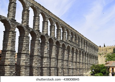 Roman Aqueduct Segovia Spain. The aqueduct of Segovia is a Roman aqueduct located in the Spanish city of Segovia. Its construction dates back to the early second century. C.. Emperor Trajan.
