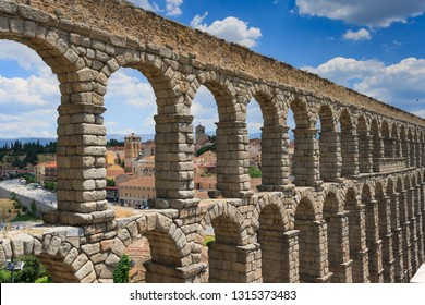 Roman Aqueduct under the sky with some clouds, Segovia, Spain