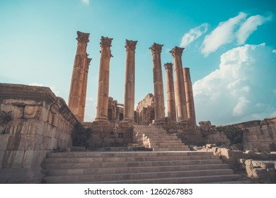 Roman architecture. old historic district of Jarash. High beautiful antique columns against the blue sky. Temple of Artemis in the ancient Roman city of Gerasa in Jarash, Jordan.