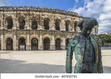 Roman Arena (Amphitheater) in Arles and bullfighter sculpture, Provence, France