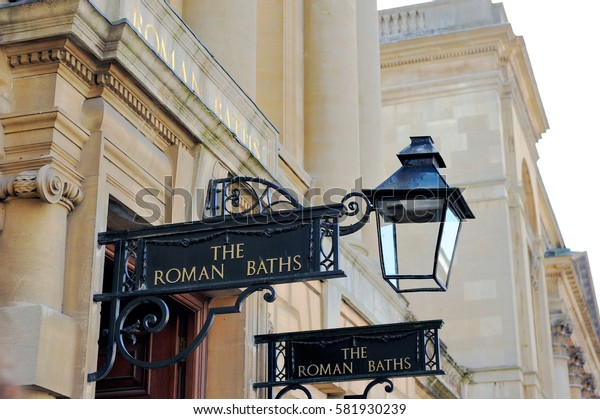 Roman Bath sign hanging by the doorway, Bath, England