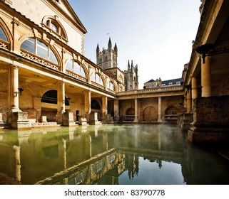 Roman Baths with Bath Abbey reflection in Bath, England