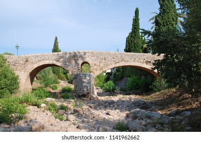 The Roman bridge across the Torrent de Sant Jordi at Pollenca on the Spanish island of Majorca.