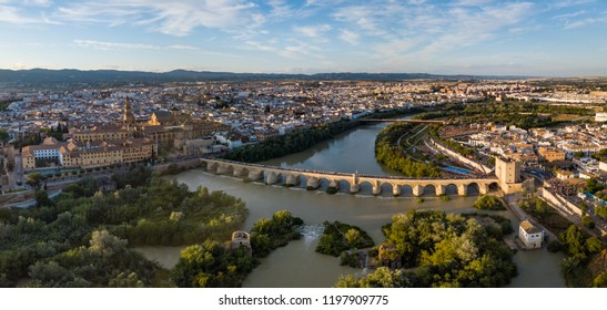 Roman Bridge aerial panoramic view with Mezquita Cathedral in the background. Cordoba. Andalusia, Spain.