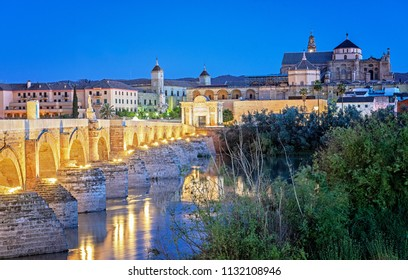 Roman Bridge and Guadalquivir river, Great Mosque, Cordoba, Spain in dusk