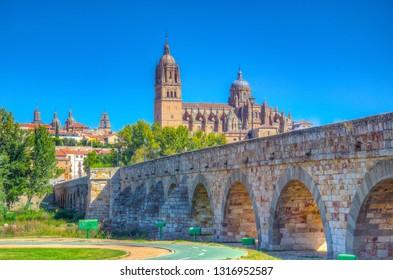 Roman bridge leading to the Salamanca cathedral, Spain
